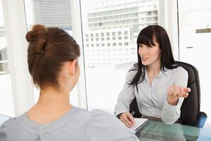 A business woman with a potential employee asks questions