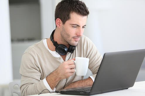 Man in front of laptop computer with headset-1