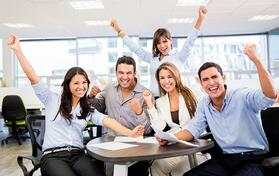 Successful business team with arms up at the office-1