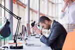 frustrated young business man working on laptop computer at office-1